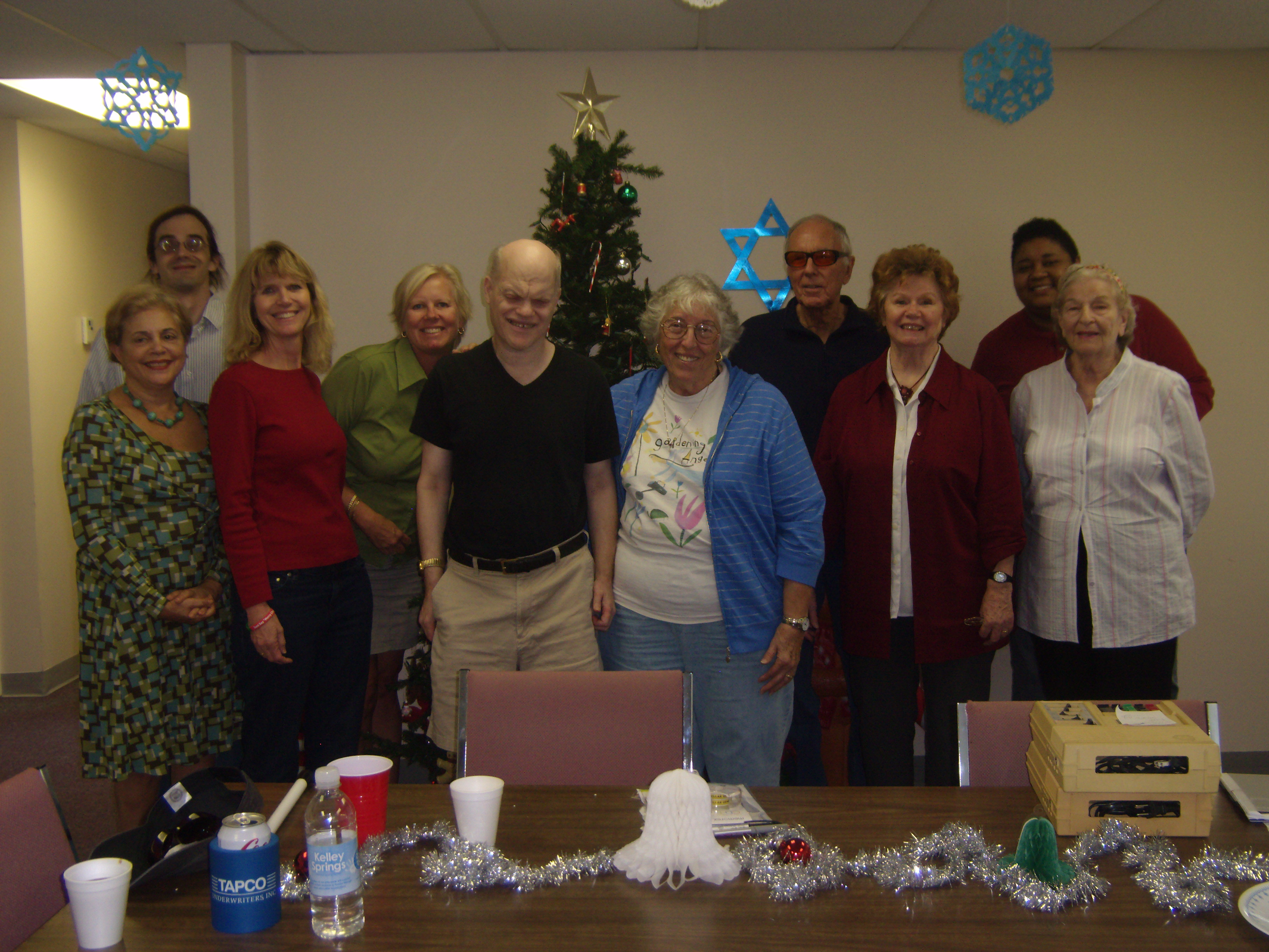 Book Club celebrates the winter holidays. Group photo of 10 Book Club members, including staff.